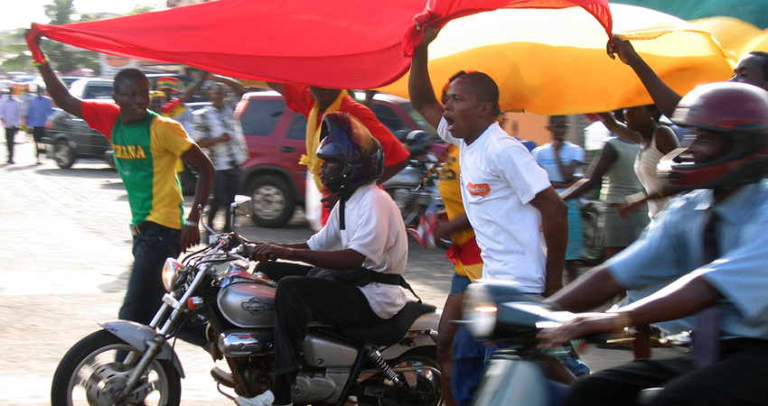 Crowd of men with motorcycle