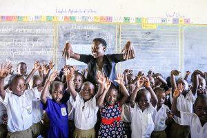 Children and teacher: Helen Manson/USAID, via Flickr